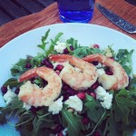 Arugula Salad topped with Grilled Shrimp, Pomegranate, Goat Cheese, and Pine Nuts