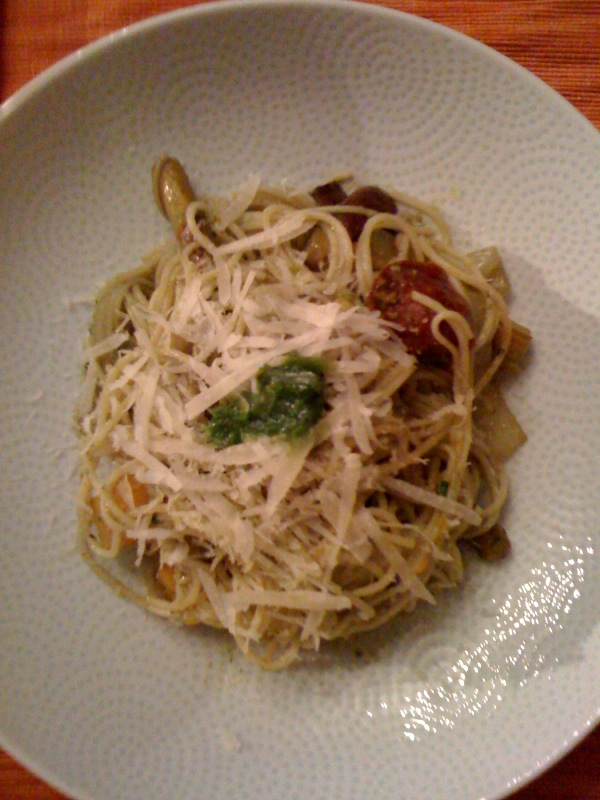 Roasted medley of spring vegetables served over angel hair pasta with chicken sausage, tossed with a cilantro pesto
