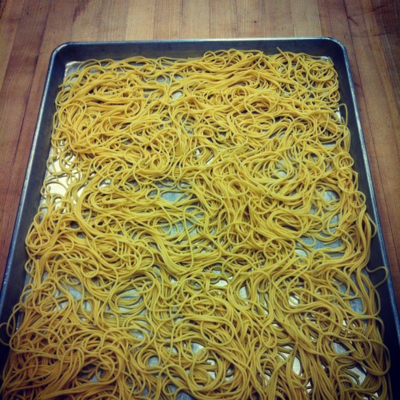 Brilliant party prep trick: The day before cook the pasta until one minute before al dente. Drain, rinse, and toss with oil. Hold on a cookie sheet in the fridge, covered with plastic wrap. To use, simply finish cooking for one minute in a pot of boiling water.